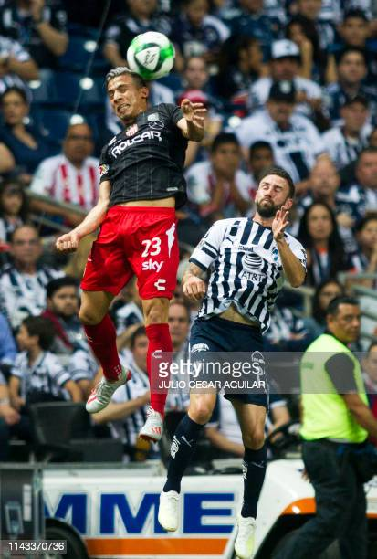 Monterrey's Miguel Layun vies for the ball with Nexaca's Angel Sepulveda during the second leg of the Mexican Clausura 2019 tournament football match...