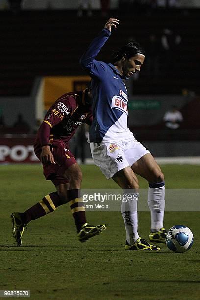 Monterrey's player Aldo Denigris vies for the ball with Estudiantes Tecos player during their match in the Bicentenario 2010 tournament, the closing...