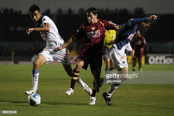 Monterrey's player Jesus Zavala vies for the ball with Rubens Sambueza of Estudiantes Tecos during their match in the Bicentenario 2010 tournament,...