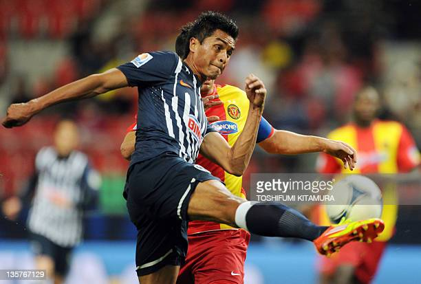 Monterry forward Sergio Santana volleys the ball beside Esperance defender and captain Khelil Chammam during their FIFA Club World Cup 5thplace...