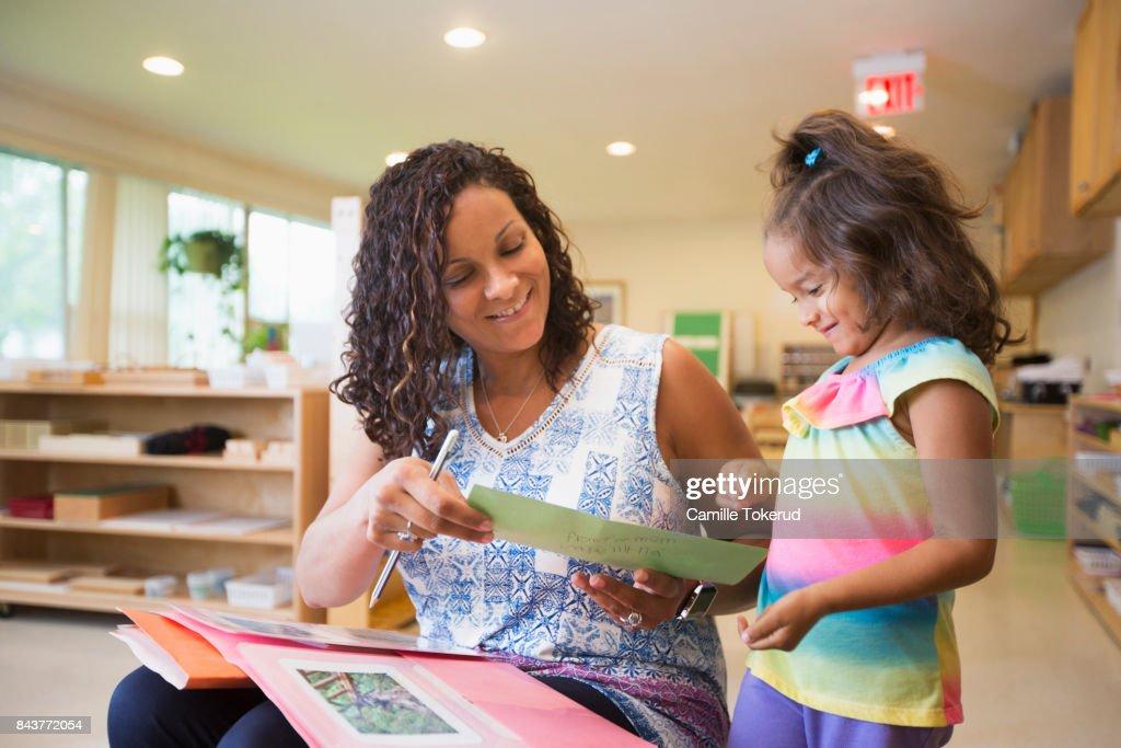 Montessori Preschool Teacher and student : Stock Photo