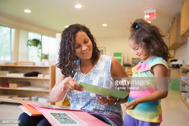 Montessori Preschool Teacher and student