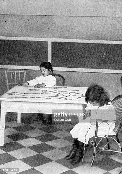 Montessori teaching method early 20th century Children counting strings of beads one of 100 and one of 1000 Educational approach developed by Italian...