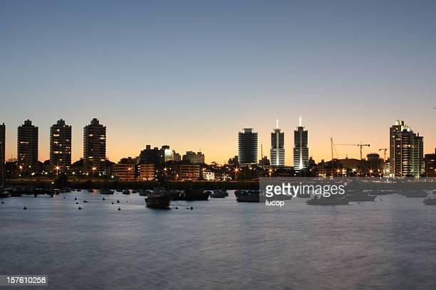 Montevideo cityscape at dusk from a marina
