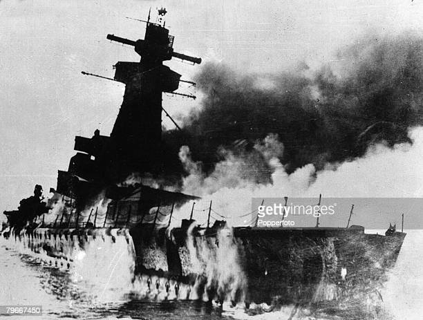 Montevideo Uruguay 17th December Smoke pours from the sinking German battleship Graf Spee after it was scuttled by its crew to stop it falling into...