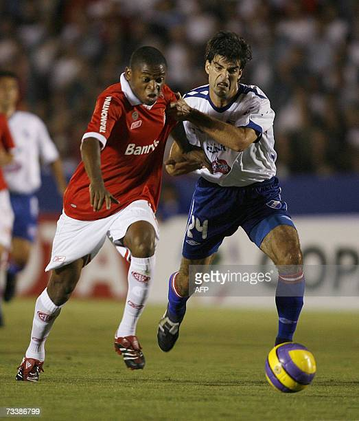 Luiz Adriano of Internacional and Alexis Viera of Nacional vie for the ball 21 February 2007 during their Libertadores Cup football match in...
