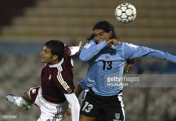 Venezuelan national soccer teamplayer Osvaldo Vizcarondo vies for the ball with Uruguayan Sebastian Abreu during a friendly match in Montevideo 18...