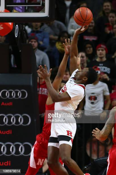 Montez Mathis of the Rutgers Scarlet Knights attempts a shot as Thomas Allen of the Nebraska Cornhuskers defends during the first half of a game at...