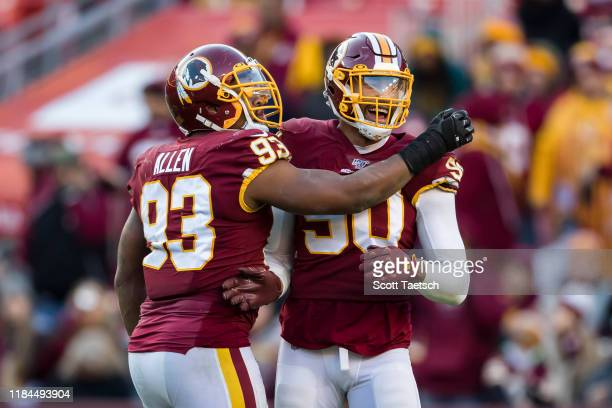 Montez Sweat and Jonathan Allen of the Washington Redskins celebrate after a play against the Detroit Lions during the second half at FedExField on...