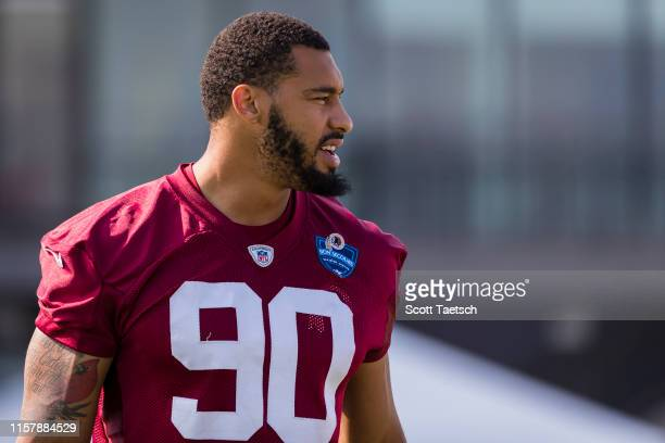 Montez Sweat of the Washington Redskins walks to the field during training camp at Bon Secours Washington Redskins Training Center on July 26 2019 in...