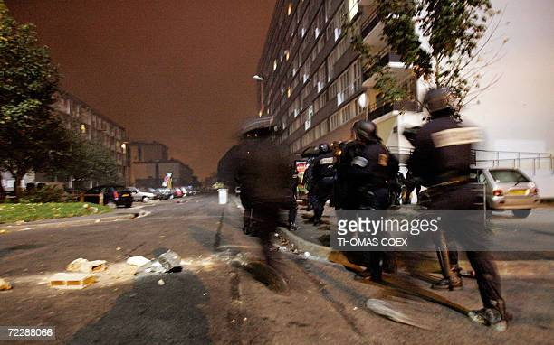French police prepare to assault during clashes against residents in Montfermeil Northern Paris 28 October 2006 Thousands of extra police moved into...