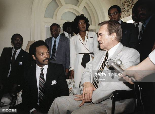 Montgomery Alabama' Alabama Governor George C Wallace and Civil Rights leader Jesse Jackson during a meeting at the Governors' mansion Far right is...