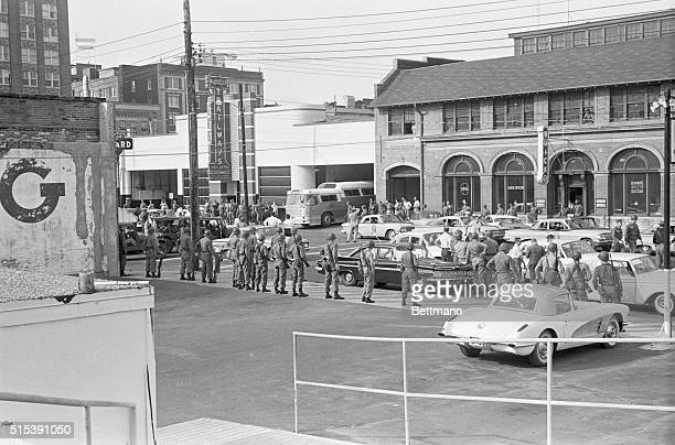 'Freedom Riders' Leave Alabama This general view shows Trailways bus with 'Freedom Riders' aboard leaving the bus terminal with State Troopers and...