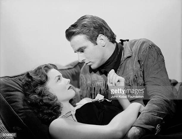 Montgomery Clift and Joanne Dru share a romantic moment in the Howard Hawks western 'Red River'