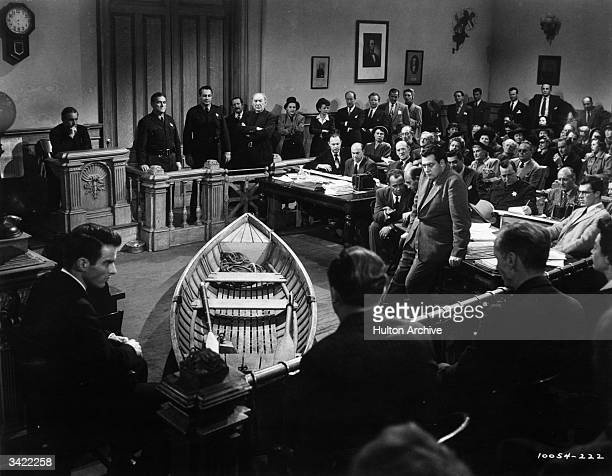 Montgomery Clift and Raymond Burr appear in a courtroom scene from the melodrama 'A Place In The Sun' with the incriminating rowing boat in the...