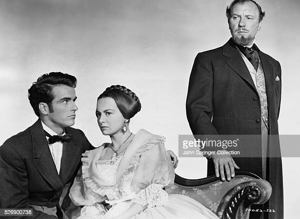 Montgomery Clift as Morris Townsend, Olivia de Havilland as Catherine Sloper, and Ralph Richardson as Dr. Austin Sloper in The Heiress .