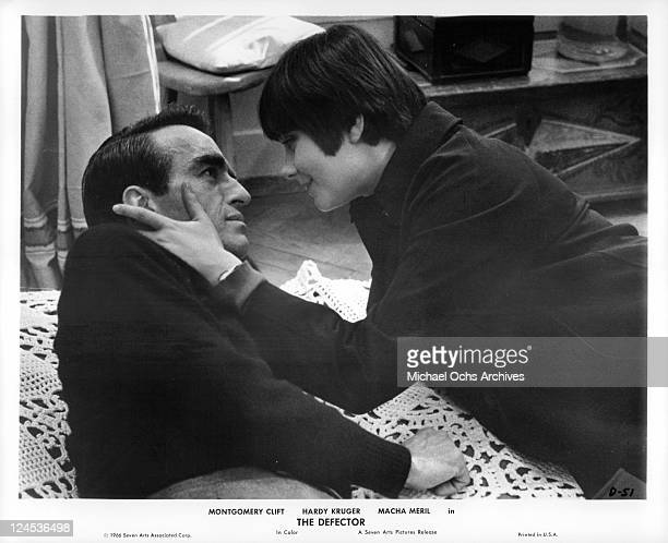 Montgomery Clift shares intimate moment with Macha Meril in a scene from the film 'The Defector', 1966.