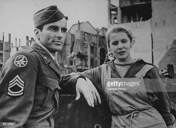 Montgomery Clift, the American film star, as a GI, and Corneilia Bursch, during the shooting of some scenes for a new film by 20th Century Fox.