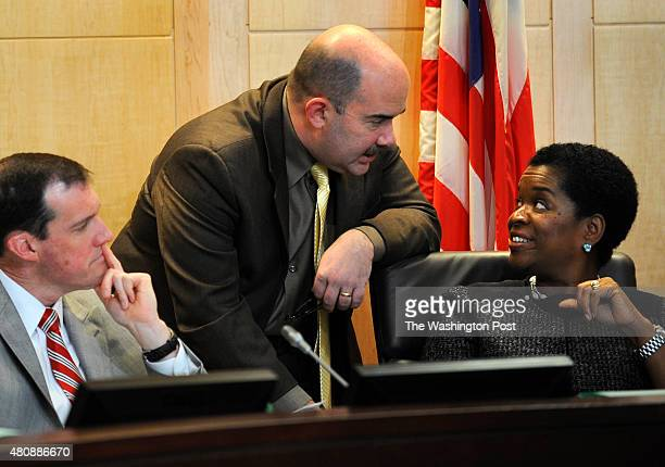 Montgomery County Council members from left Mike Knapp George Leventhal and Valerie Ervin powwow during a session Tuesday February 2 in the hearing...