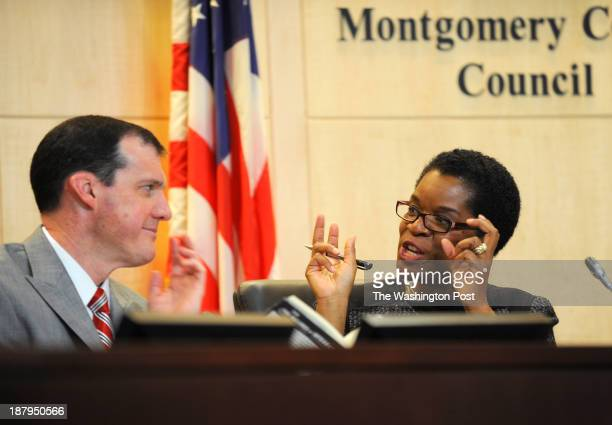 Montgomery County Council members Mike Knapp and Valerie Ervin chat during a meeting Tuesday February 2 in the hearing room at the Montgomery Council...