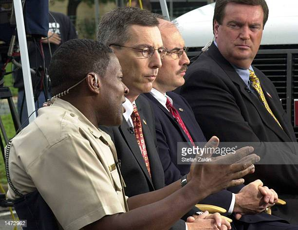 Montgomery County Police Chief Charles Moose gestures as Federal Bureau of Investigation Special AgentinCharge Gary Bald Alcohol Tobacco and Firearms...