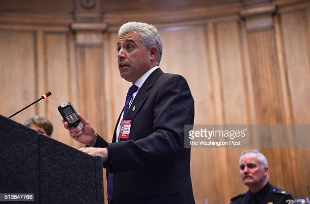 Montgomery County Police Chief Tom Manger right listens as Rich Leotta holds an ignition interlock device while speaking at a MADD press conference...