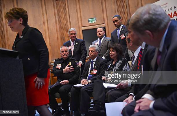 Montgomery County Police Chief Tom Manger seated left sits beside Rich Leotta and his wife Marcie Goldman parents of Montgomery County Police Officer...