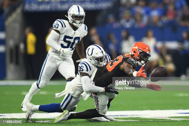 J Montgomery of the Cleveland Browns is defended by Pierre Desir of the Indianapolis Colts during the first half at Lucas Oil Stadium on August 17...