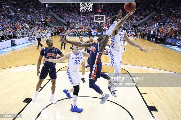 Montgomery of the Kentucky Wildcats blocks a shot by Jared Harper of the Auburn Tigers during the 2019 NCAA Basketball Tournament Midwest Regional at...