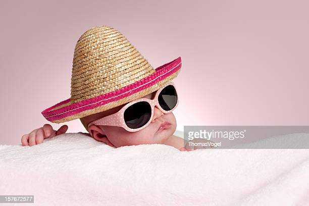 1 month baby girl with pink sunglasses and sombrero hat