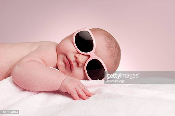 1 month baby girl with pink sunglasses