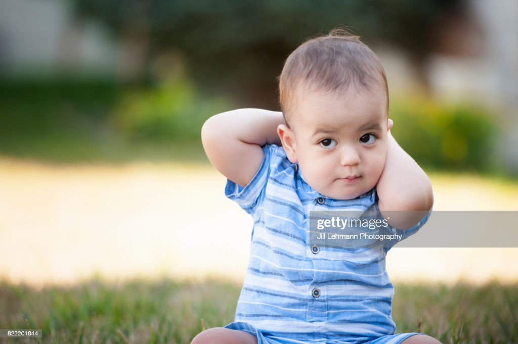 12 month Beautiful Fraternal Twin Baby Sits in Grass and Poses : Stock Photo