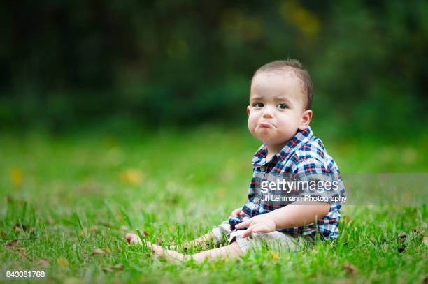 12 month Beautiful Fraternal Twin Baby Sits in Grass