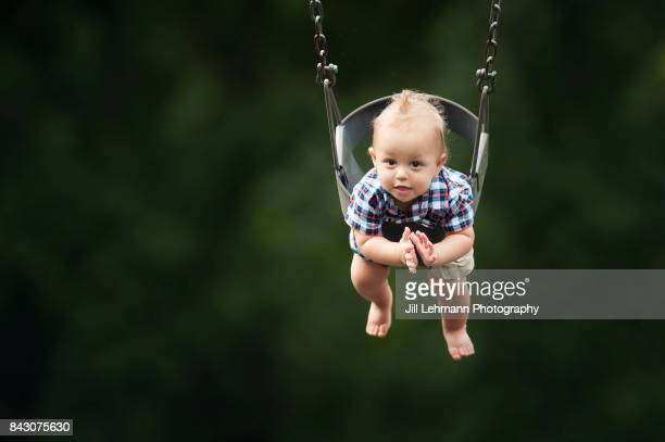 12 month Fraternal Twin Baby Claps While Swinging