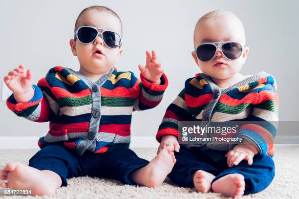 8 month fraternal twin boys play together - cute twins stock photos and pictures