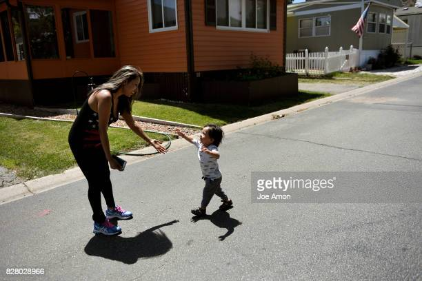 18 month old Anibal Jurado runs his mother Ingrid Encalada Latorre on their street in Westminster after living at the Mountain View Friends Meeting...