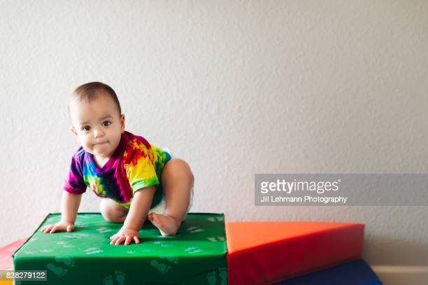 12 Month Old Baby Climbs on Foam Blocks While Making a Face