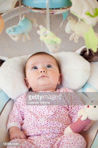 5 Month Old Baby Girl Starring At Mobile High-Res Stock ...