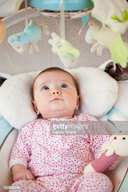5 month old baby girl starring at mobile