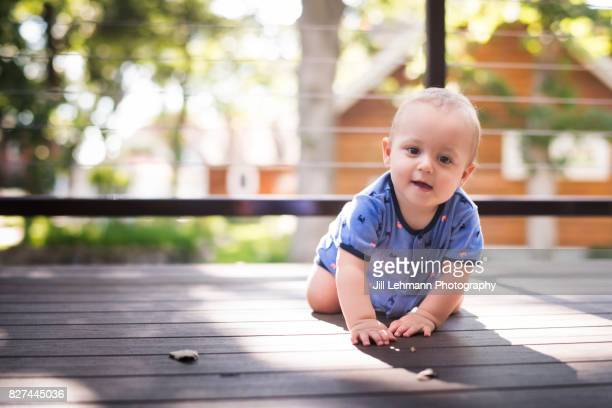 12 Month Old Baby Laughs While Sitting on a Deck