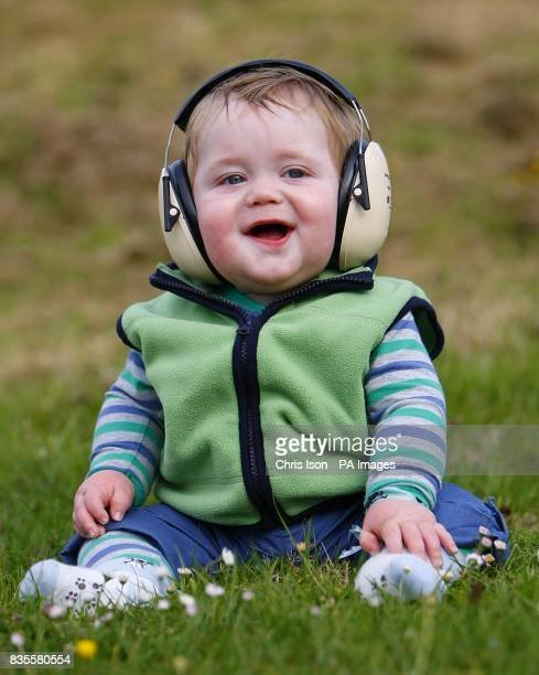 10 month old Caleb Bickell protects his ears from the loud music at the Isle of Wight festival in Newport on the Isle of Wight