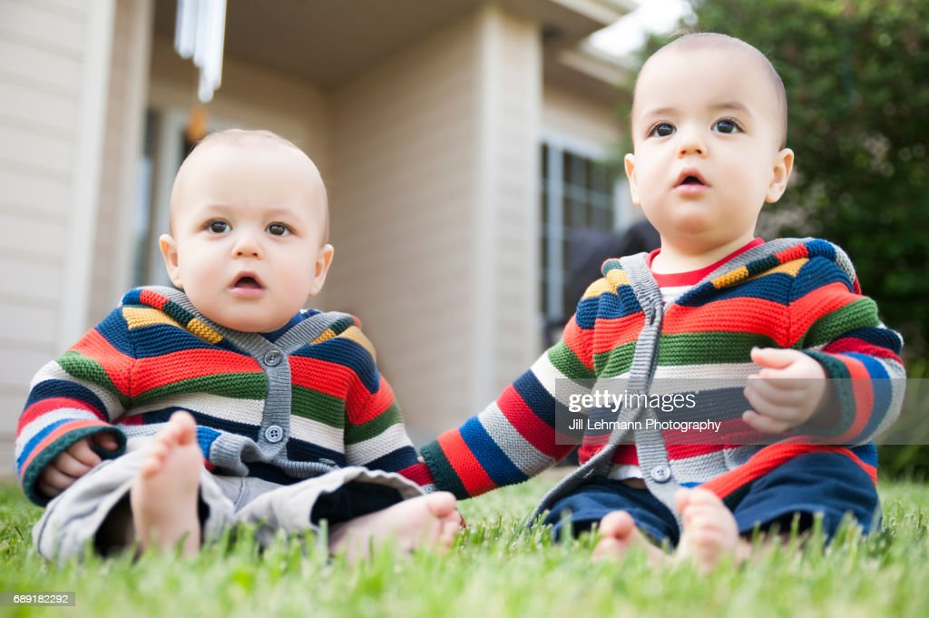 12 Month Old Fraternal Twin Baby Boys Play Together Outside : Stock Photo