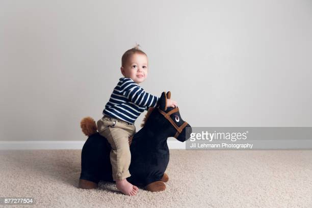 15 Month Old Fraternal Twin In Stripes Rides a Tony Pony At Home