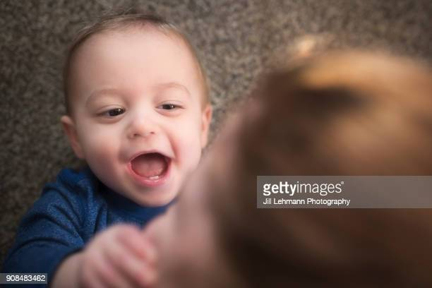 18 Month Old Fraternal Twin Laughs While Being Tickled By Mother