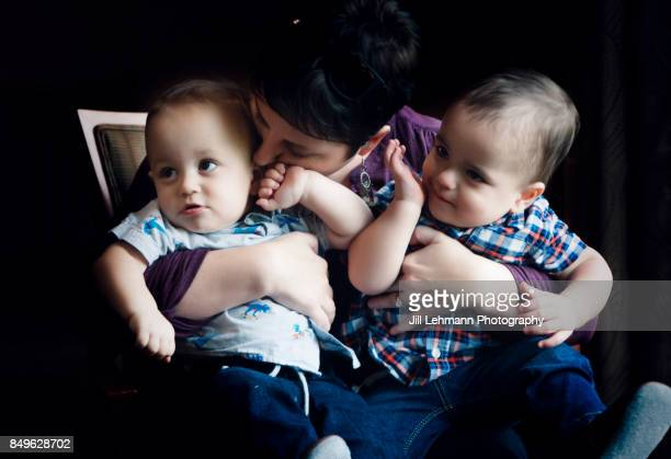 12 Month Old Fraternal Twins are embraced by Mother