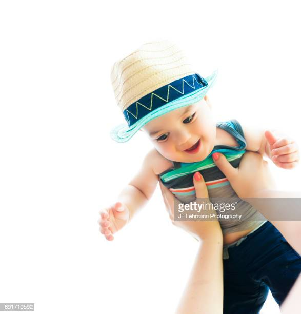 11 Month Old is Thrown in the Air by Mother Wearing a Fedora Outside