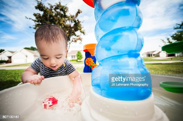 12 Month Old Splashes Water in Water Table