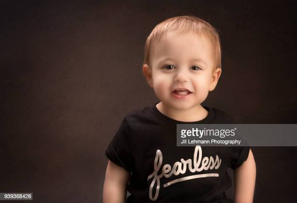 9c1cf138b 20 Month Toddler Smiles For Camera Wearing a Shirt that Says