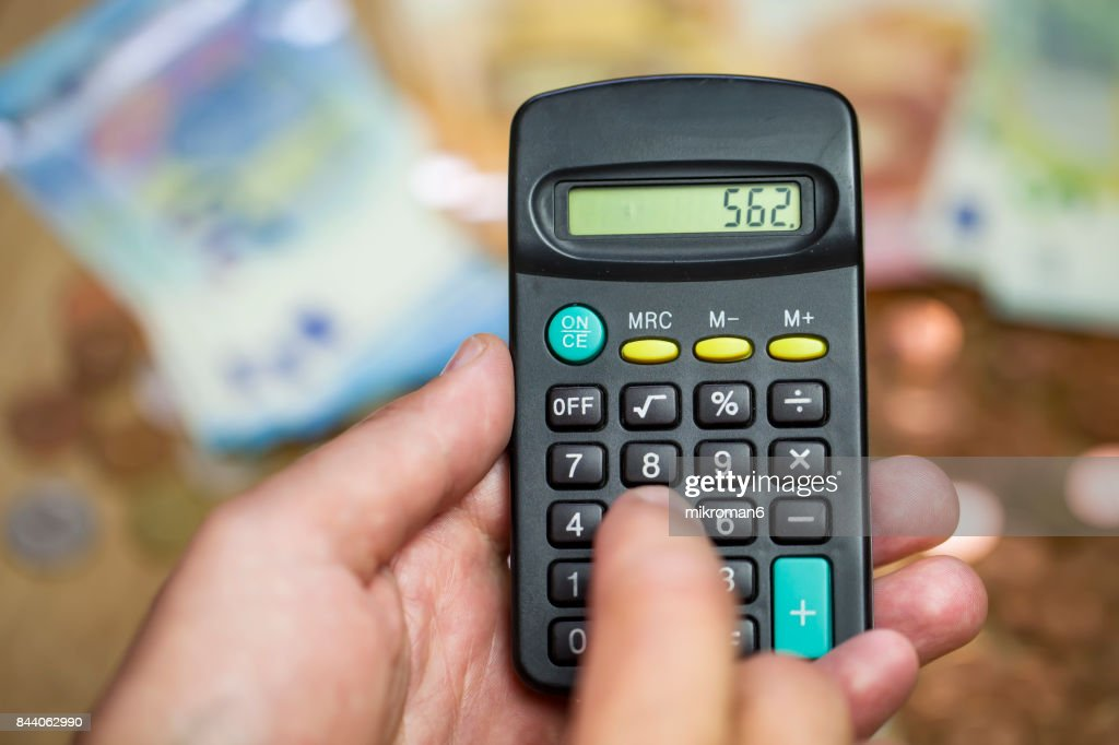 Monthly Expense Calculation Closeup Of Mans Hand Using Calculator To