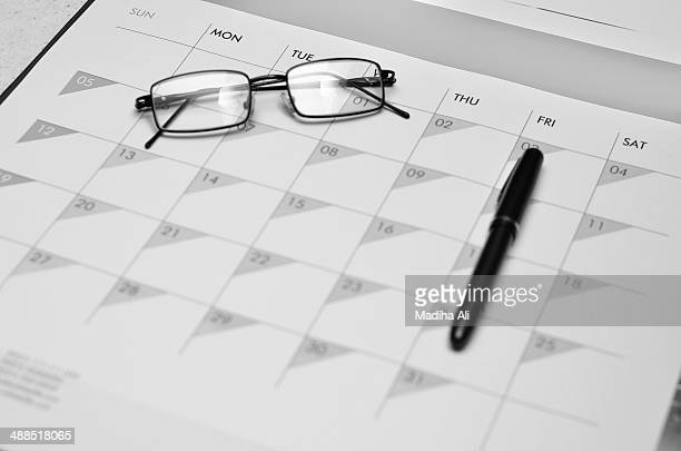 monthly planner with a pen and glasses! - bahawalpur stock pictures, royalty-free photos & images